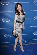 http://img154.imagevenue.com/loc238/th_751848836_Rose_McGowan_Millennium_Network_Event_in_Hollywood_March_17_2011_08_122_238lo.jpg